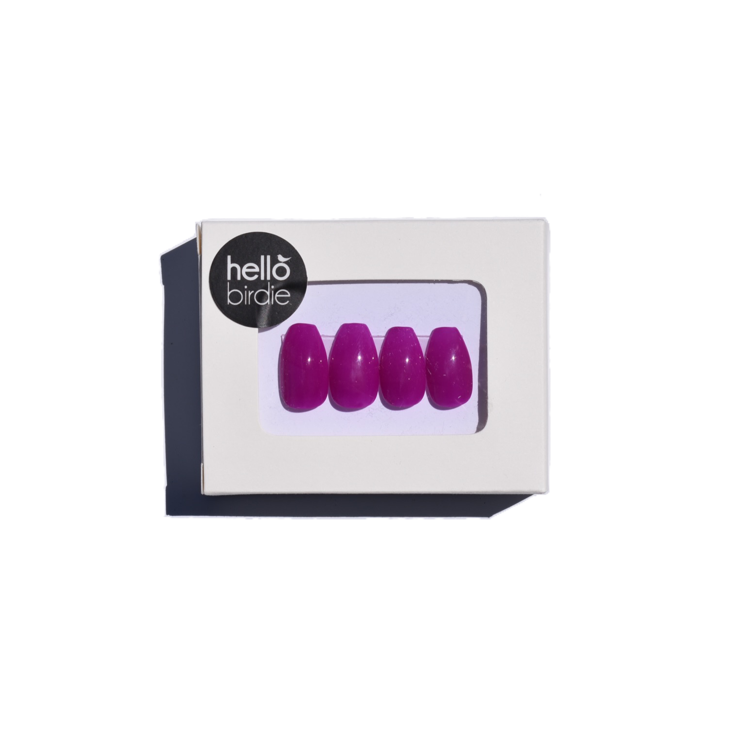 Four press-ons packaged in a rectangular box with a Hello Birdie logo on the top left corner.  A window with rounded corners allows you to view the fuschia gloss coffin shaped nails.