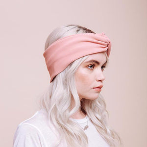 Side view of model wearing pink Baby Doll Turban headband