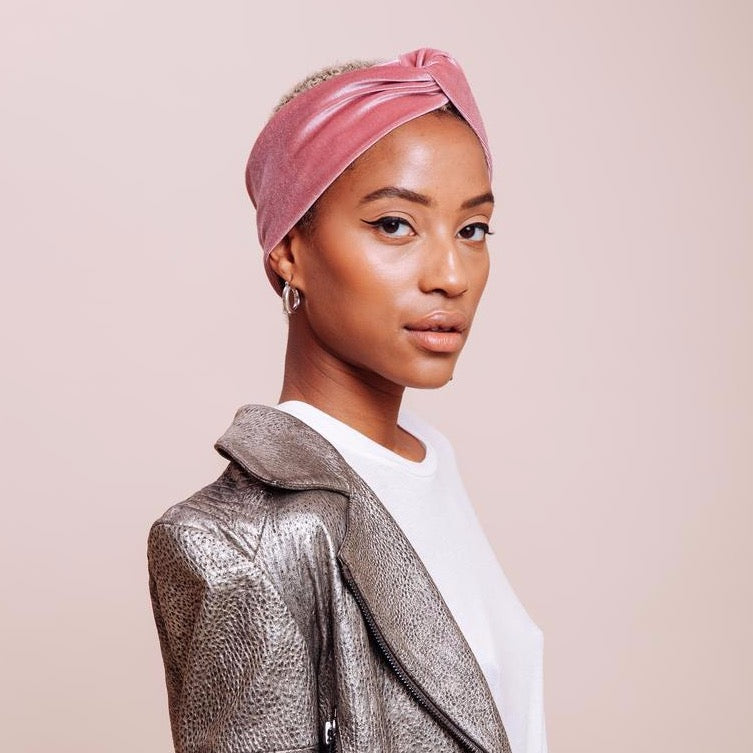 Side view of model wearing pink velvet Baby Venus Turban Headband