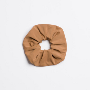 Matte tan Wild Horses Scrunchie from I'm With the Band laying flat