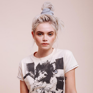 Light grey velvet Silverado Scrunchie styled on a model in a messy top bun front view