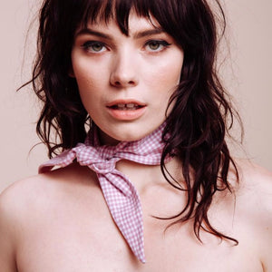 close up of model wearing a Loretta Rose Scarf Tie around her neck