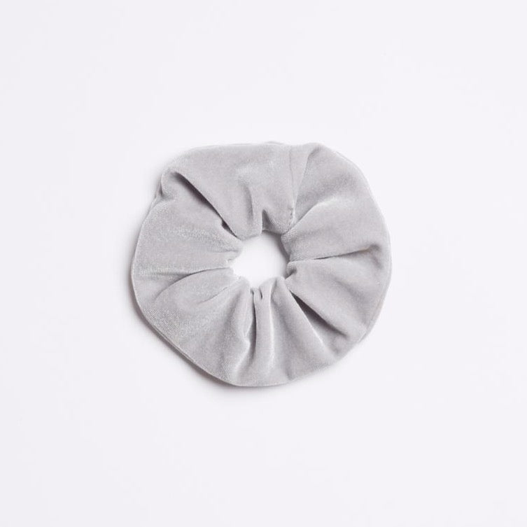 Light grey velvet Silverado Scrunchie from I'm With the Band laying flat
