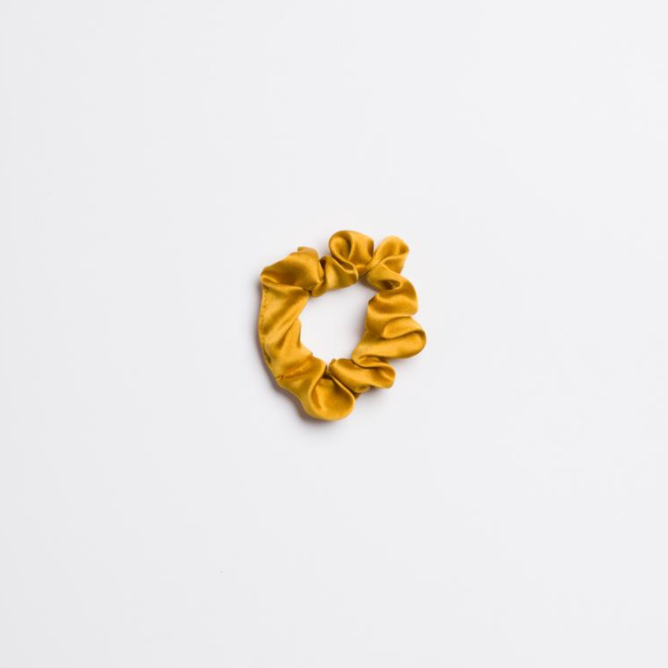 Marigold Mini Scrunchie in silk from I'm With the Band laying flat