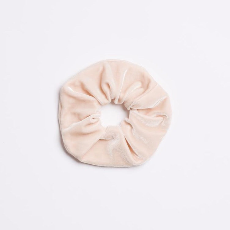 Light cream velvet Moonstone Scrunchie from I'm With the Band laying flat