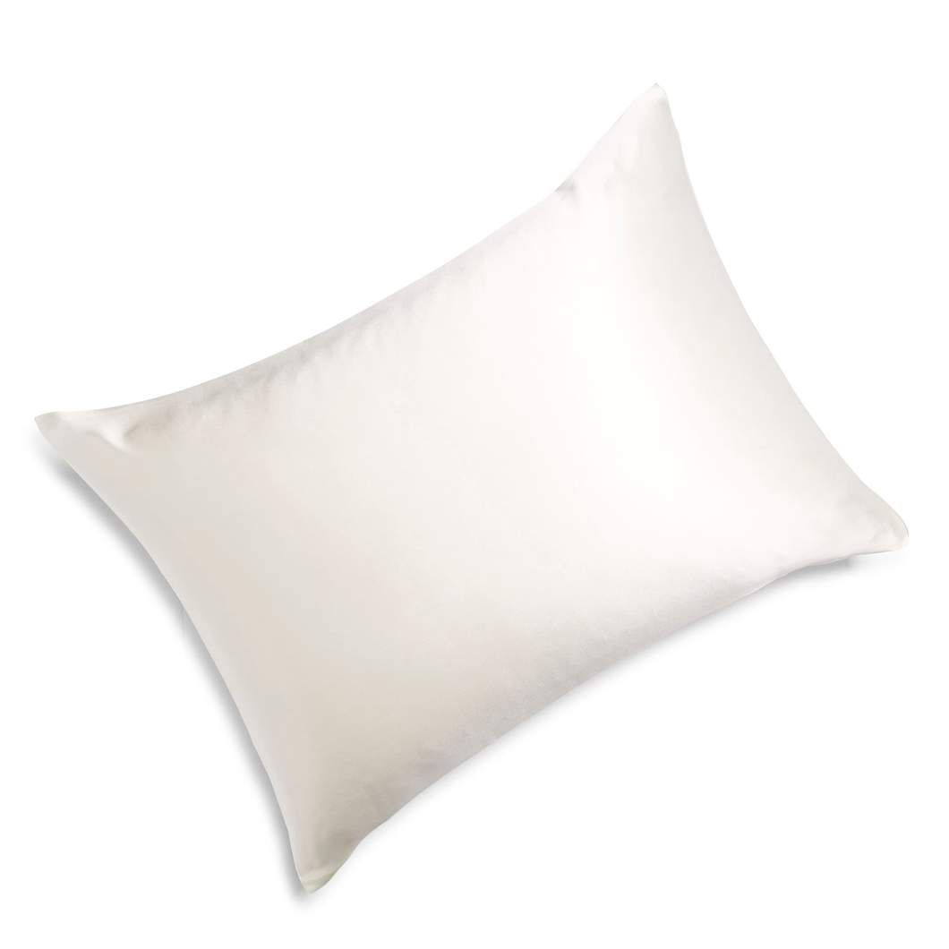 Overhead view of a fluffy pillow with an ivory white silk pillowcase on and a white background.