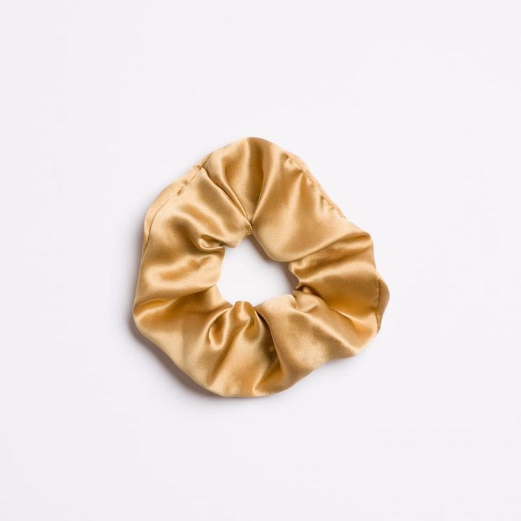 Gold Rush Scrunchie in silk and light gold color from I'm With the Band laying flat