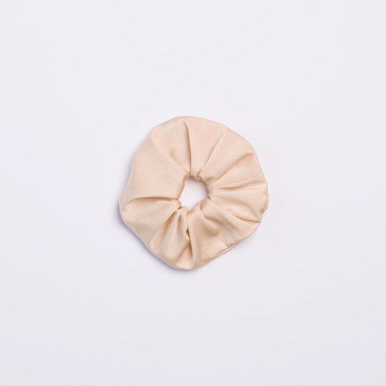 Cream colored Milky Way Scrunchie from I'm With the Band laying flat