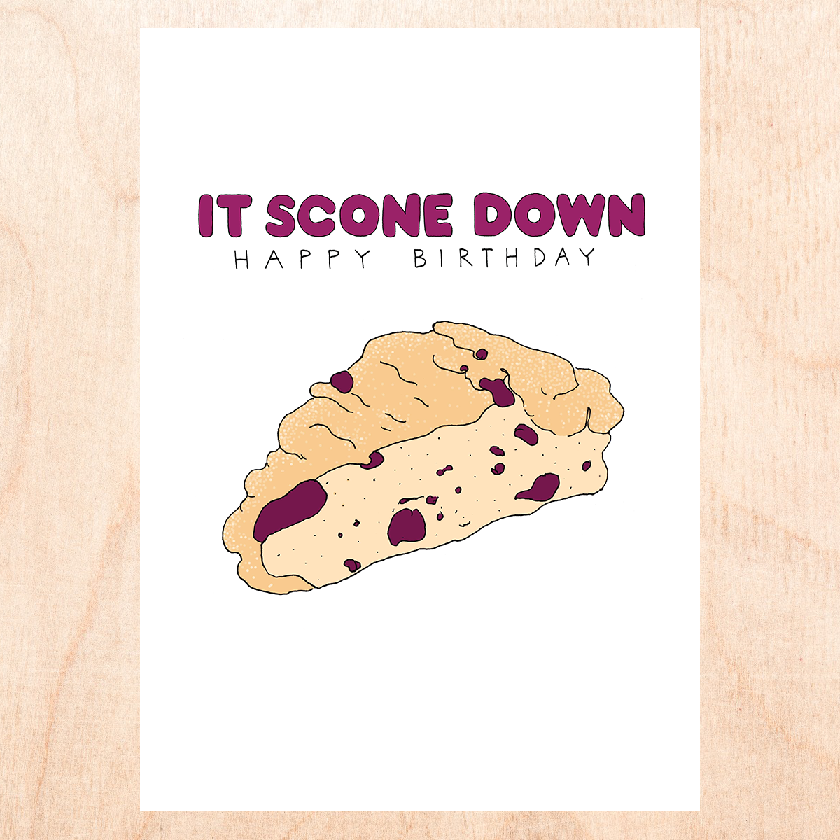 "White background with cartoon drawing of a sliced fruity scone that reads, ""it scone down- happy birthday""."
