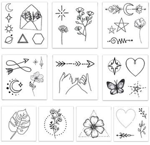 Designs including black line symbols and flowers from the Fine Line Pack Temporary Tattoos