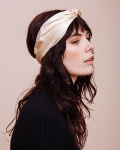 A closer view of a model wearing a Cowgirl in the Sand Turban Headband with a side view