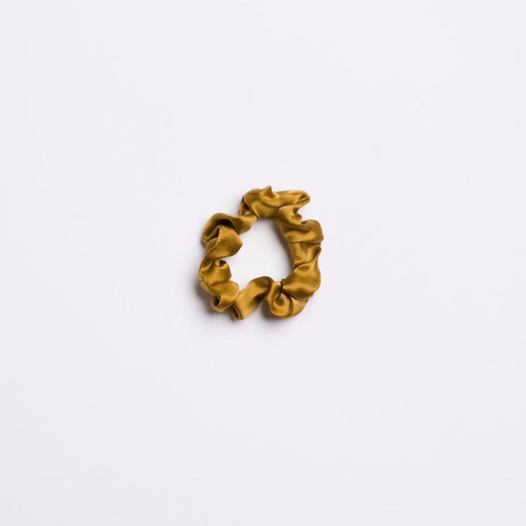 Golden Canyon Mini Scrunchie in a brownish yellow color and silk from I'm With the Band laying flat