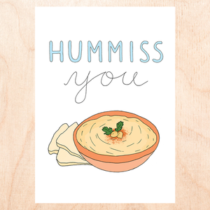 "White background with cartoon drawing of an orange colored bowl with hummus and some pita bread that reads, ""Hummiss you"""