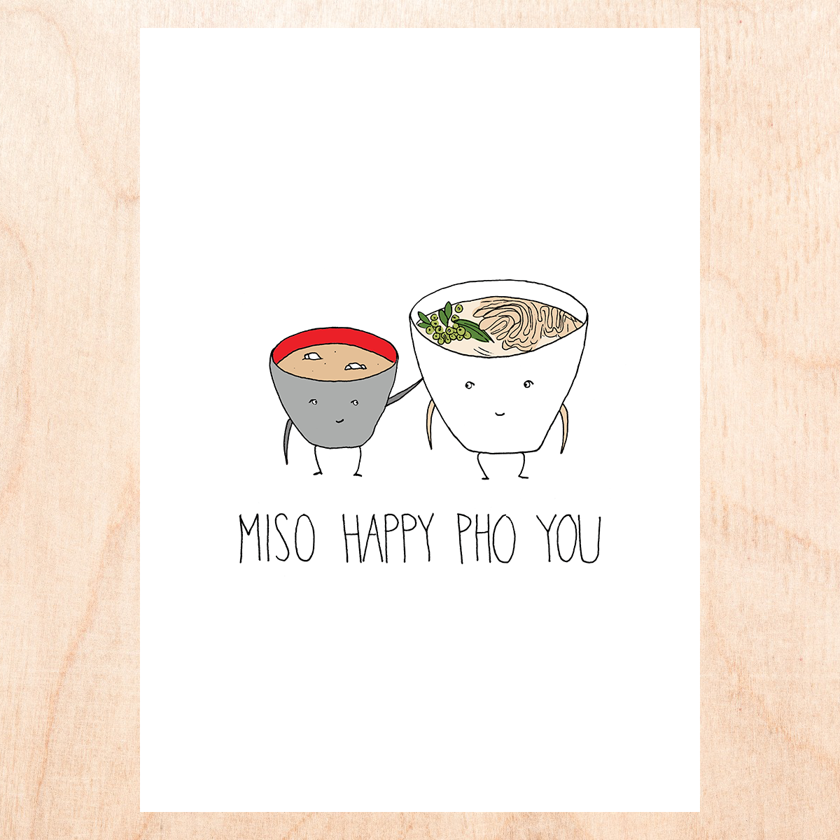 "White background with a cartoon drawing of anthropomorphic  bowls of miso soup and pho noodles (the bowls have smiling faces, arms and legs). Text reads, "" Miso happy pho you"""
