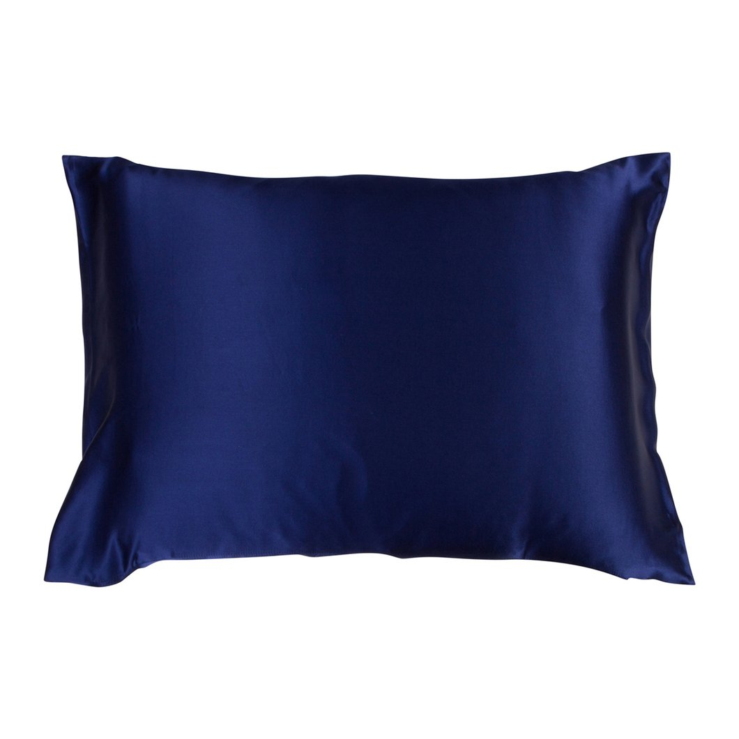 Over head image of a Night-Sky Navy Pillowcase on a fluffy pillow and a white background.