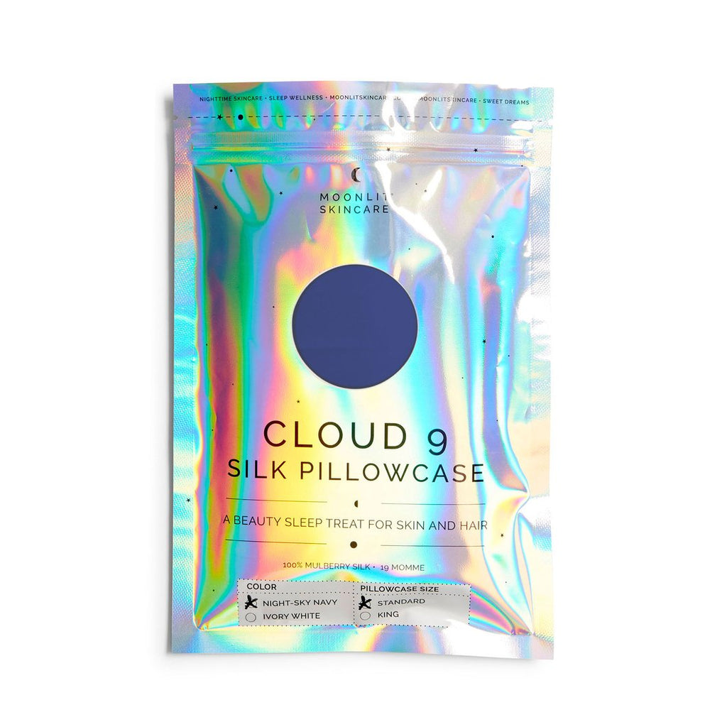 Front view of ziploc style plastic holographic package of a Cloud 9 silk Pillowcase in Night- Sky Navy.