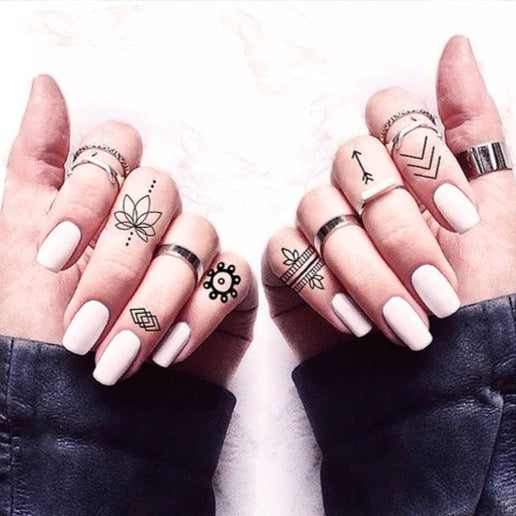 Pair of hands with Finger Tats Pack Temporary Tattoos on her fingers
