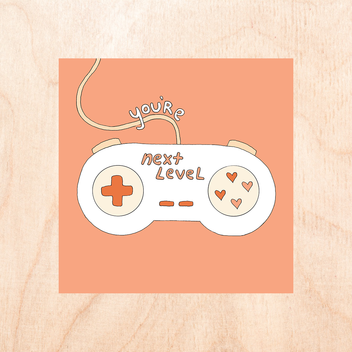"Pastel orange background with a white cartoon video game controller with text reading ""you're next level""."
