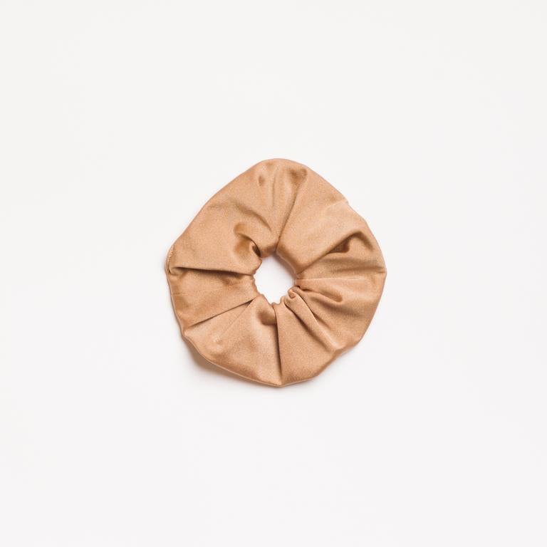 Champagne Shimmer Scrunchie that is champagne colored from I'm With the Band laying flat