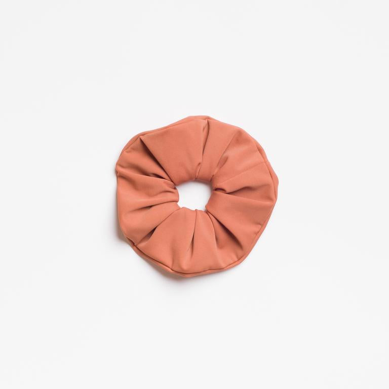 Clay matte Terra Cotta Scrunchie from I'm With the Band laying flat