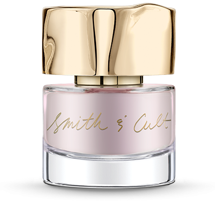 Frosted pale blush Smith & Cult nail polish bottle with gold dented cap