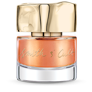 Metallic papaya Smith & Cult nail polish bottle with dented gold cap