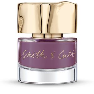 Opaque lavender mauve Smith & Cult nail polish bottle with dented gold cap