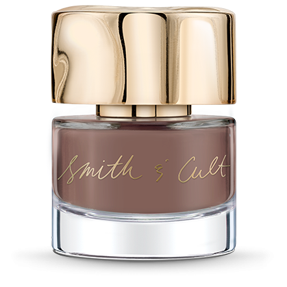 Caramel camel Smith & Cult nail polish bottle with dented gold cap