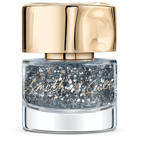 Large and small silver glitter particles suspended in a clear base Smith & Cult nail polishbottle with dented gold cap