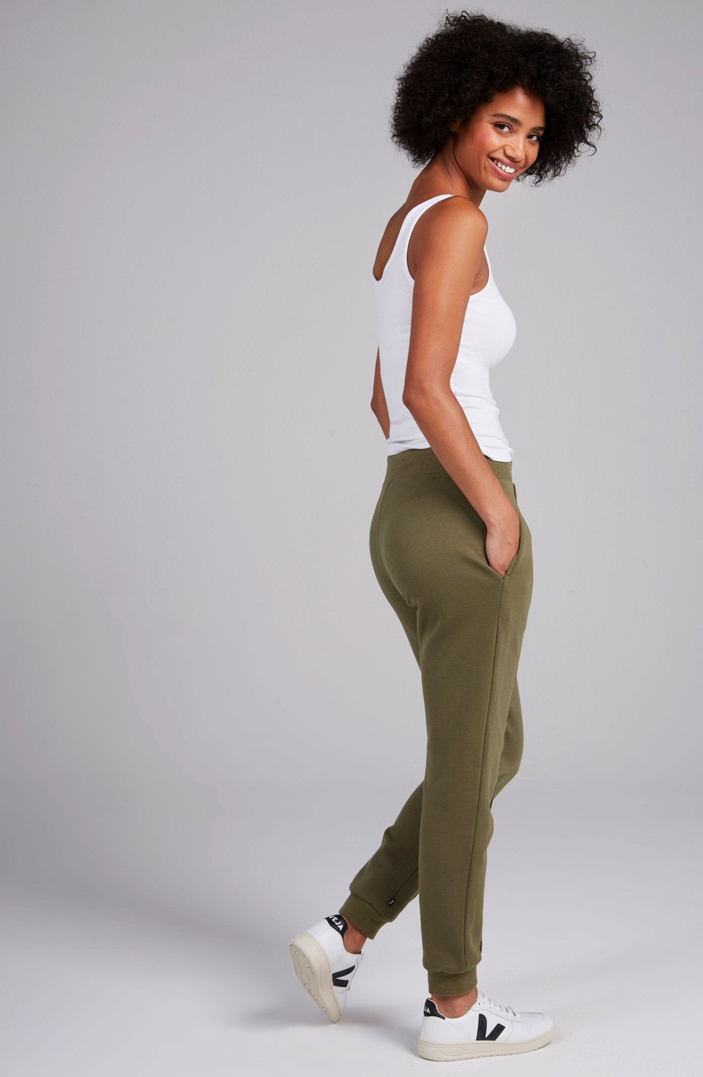 Olive fleece jogger with piping down the center of each leg