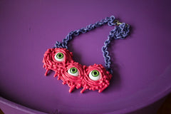 DRIPPING NECKLACE ROSE (green eyeballs)