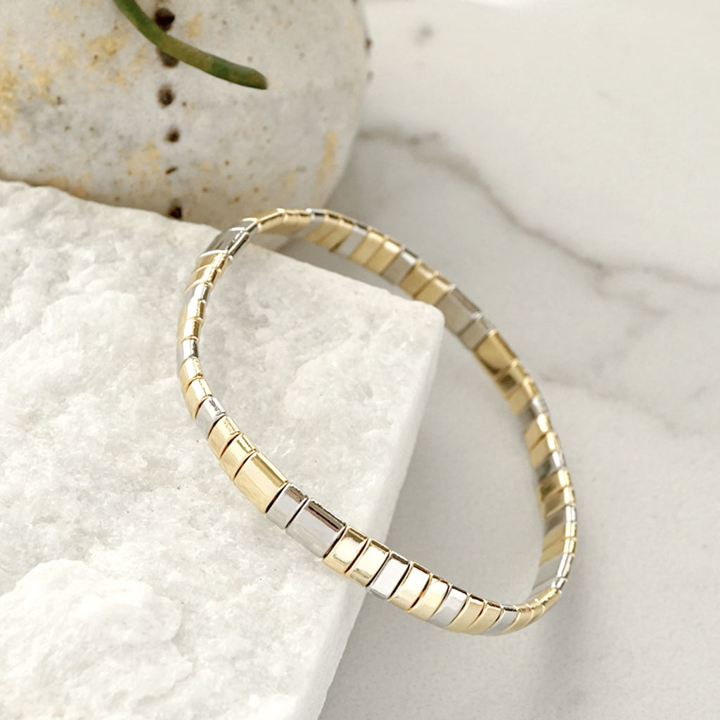 flat beads bracelet in silver and gold tone