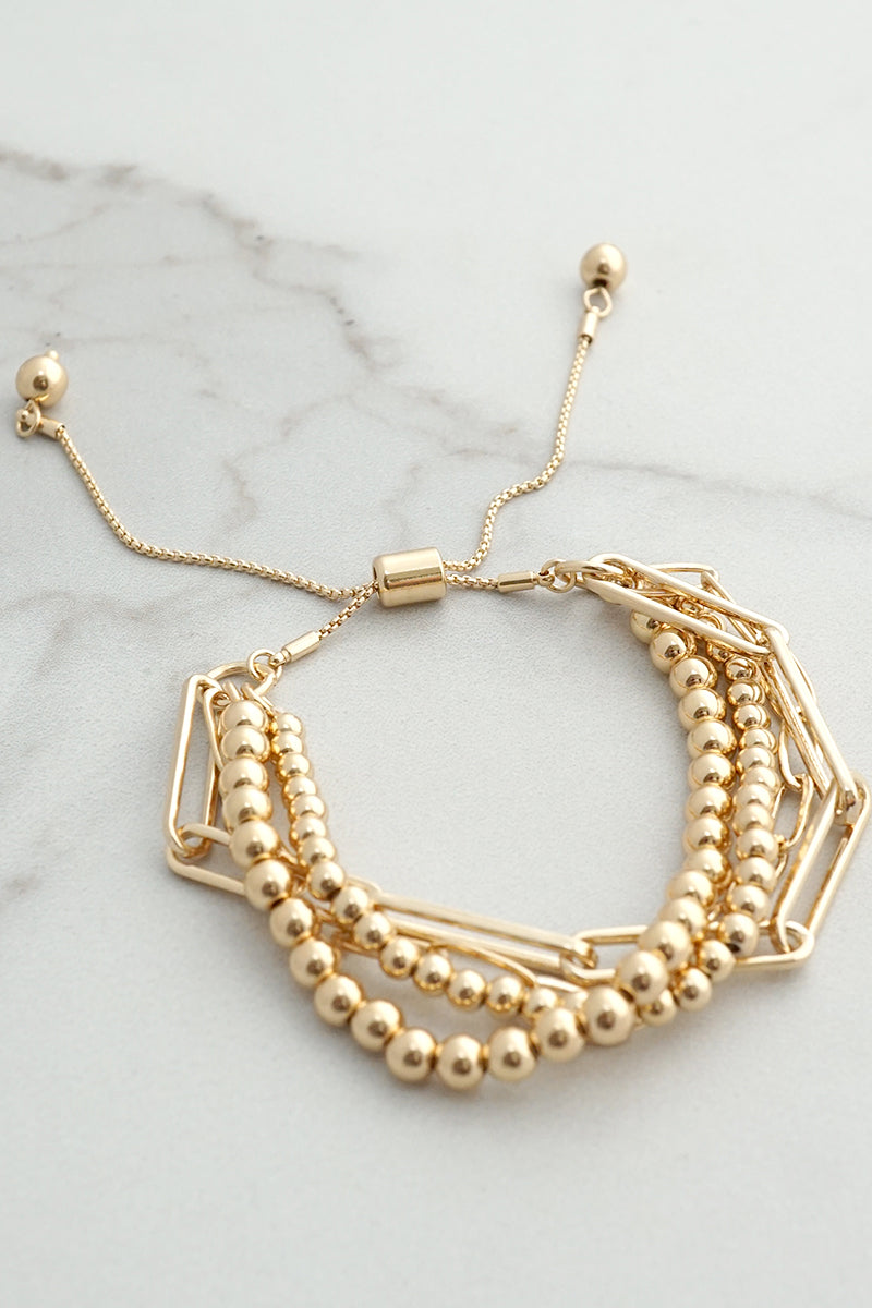 Multi layer pull tie gold bracelet