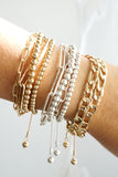 Multi layer pull tie gold tone bracelet