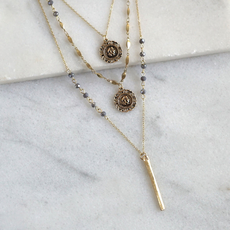 Layered medallion and bar necklace