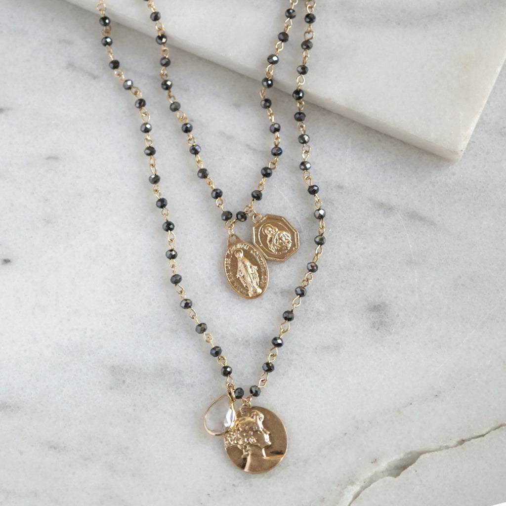 Layered medallions and charms necklace