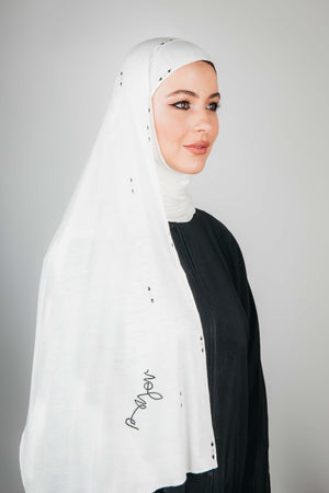 WHITE ELONGATED BROCH CRYSTALIZED COTTON STRETCH SHEILA.
