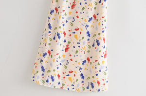 French vacation style colorful spotted halter bow suspender dress