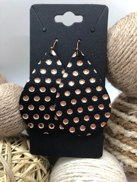 Rose gold dots on black leather