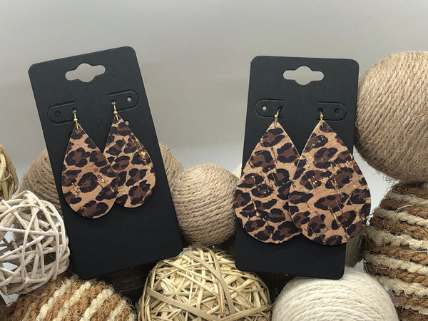 Black and brown leopard print on cork with hints of gold