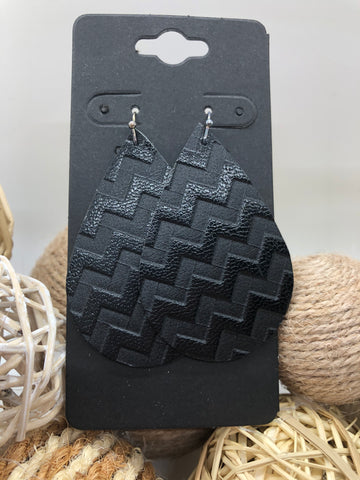 Black leather with a zigzag embossed texture