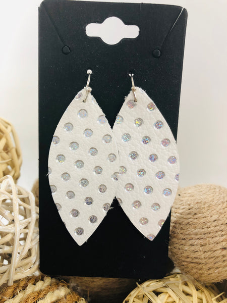 White with iridescent silver dots