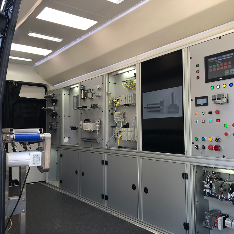 Inside look at TECO's automation van with panels showing components