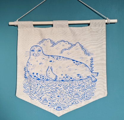 Seal hand-illustrated wall hanging