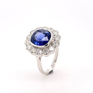 deep blue sapphire  with milgrain edge and diamond cluster ring
