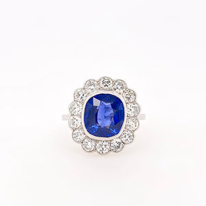 deep blue sapphire and diamond cluster ring