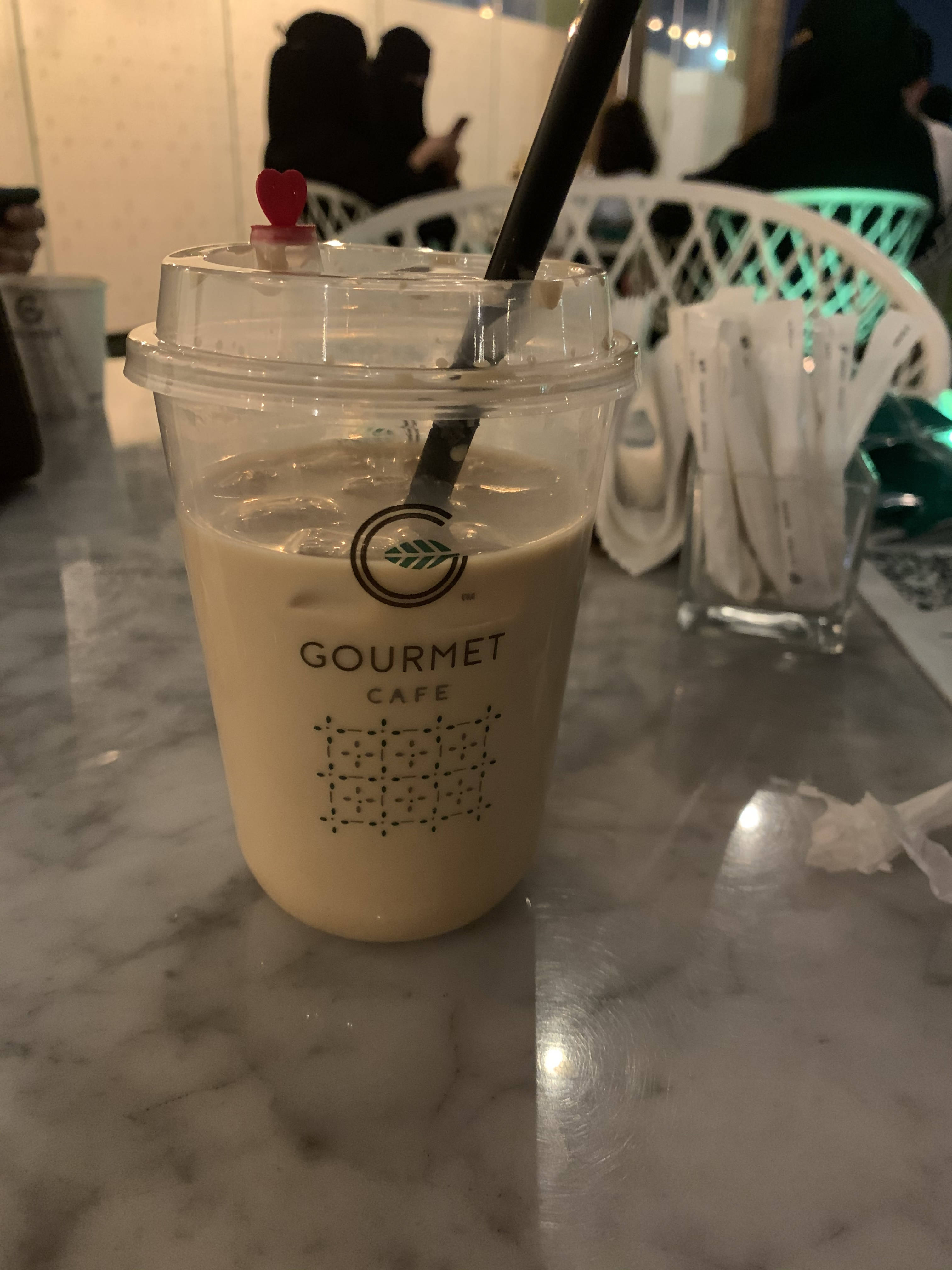 Cold coffee cups and regular and strawberry cover juices