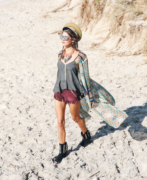 Whims and whispers cape, Poppy camisole in Olive by Kultcha collective. Hats by fallen broken street, Byron bay
