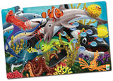 This Puzzle Double series takes the concept of a traditional puzzle to a whole new level! After putting together the 100 piece puzzle, turn off the lights and see a surprise as it glows in the dark. This Glow in the Dark puzzle provides a fun way to expand your child's knowledge of ocean animals! Each Glow in the Dark puzzle has 100 puzzle pieces and measures at 3' X 2'! Ages 3+ years.