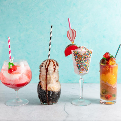 colorful ice cream in glasses different shapes light blue background tipsy scoop